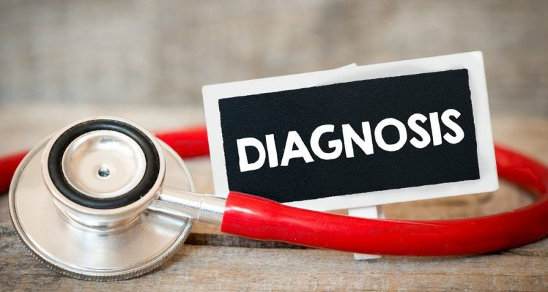 Limb-Girdle MD Diagnosis | Muscular Dystrophy News | Image of red stethoscope and small label that reads 'diagnosis'