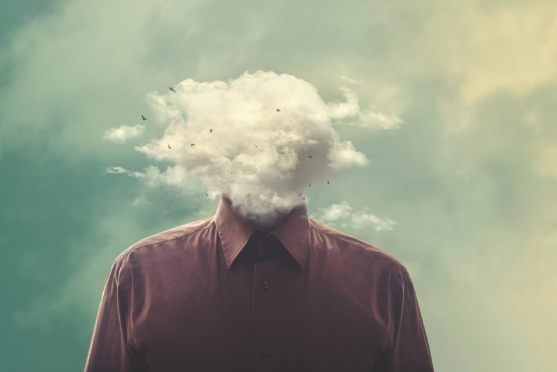 Guilt and Chronic Illness / Muscular Dystrophy News / Man in collared shirt with his head in the clouds