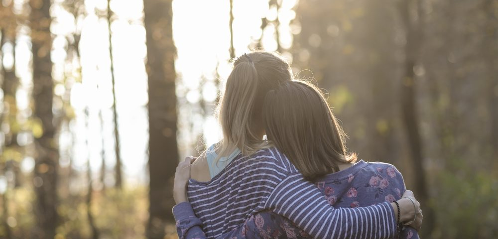 Siblings \ Muscular Dystrophy News \ A stock image of two women siblings or friends in an embrace.